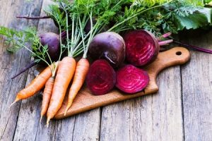 45903618 - fresh beet and carrots on wooden background